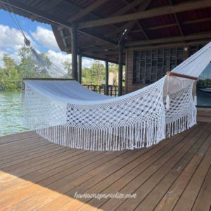 big white hammock with macramé flying